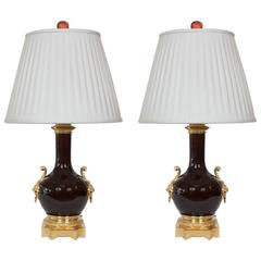 Pair of Chinese Oxblood Lamps with French Ormolu by Gagneau of France