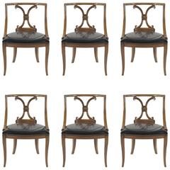 Six Mid-Century Modern Wood and Leather Chairs