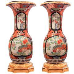 Pair of Japanese Kutani Urns on Gilt Bronze Pedestals