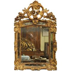 Early 18th Century French Giltwood Mirror with Flower Carving