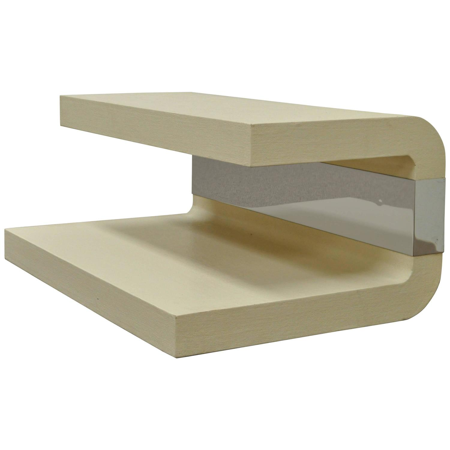 lacquered grass cloth and chrome sculptural coffee table