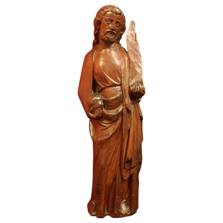 Carved Wooden Figure of a Saint Holding a Phylactery