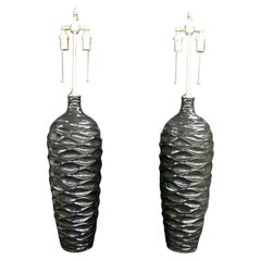 "Majestic Pair of ""Wave"" Pattern Black, Glazed Vessels with Lamp Application"