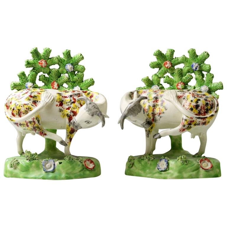 Staffordshire Pottery Figures of Cows on Bases with Bocage Pearlware Glaze For Sale
