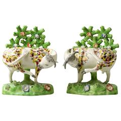 Staffordshire Pottery Figures of Cows on Bases with Bocage Pearlware Glaze