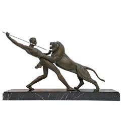 French Art Deco Hunter and Lion Sculpture Signed by Limousin