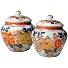Pair of Covered Japanese Imari Urns