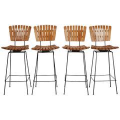 Set of Four Arthur Umanoff Iron and Slat Wood Swivel Bar Height Stools
