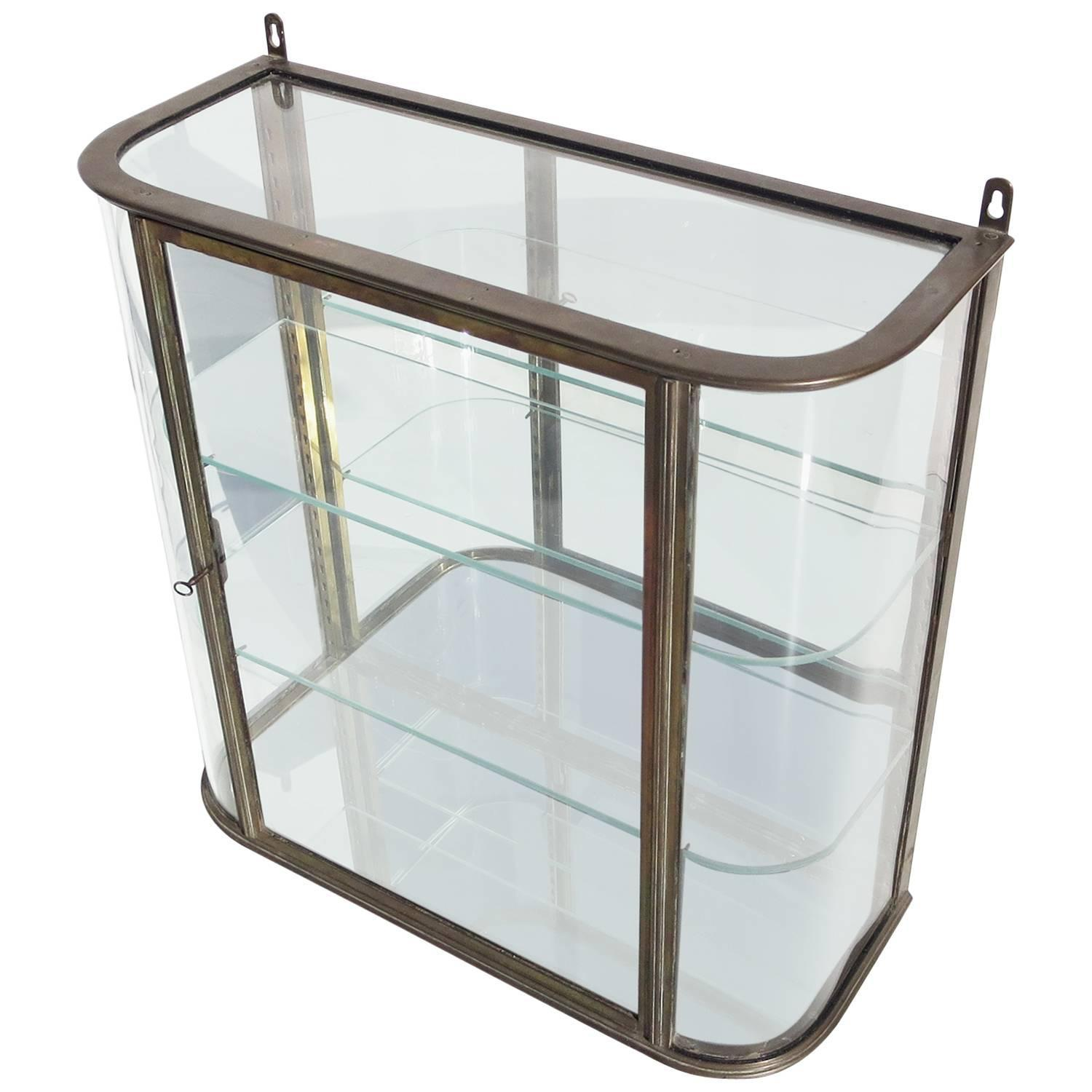 Bronze and curved glass wall mounted vitrine at 1stdibs for Curved glass wall