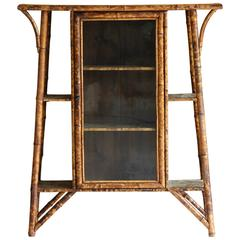 19th Century English Burned Bamboo Glass Door Cabinet with Embossed Leather