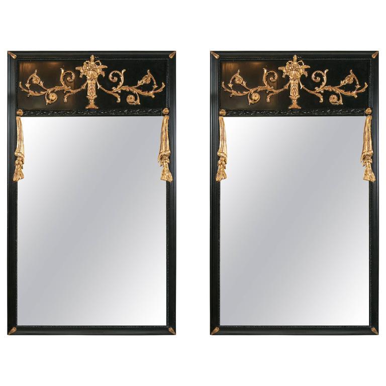 Pair of Ebonized Gilt Drapery Form Carved Trumeau Mirrors Gilt Leaf Corners