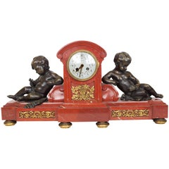 Rouge Marble and Bronze Mantel Clock by Tiffany and Company with Seated Putti