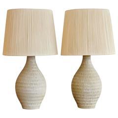 Pair of Incised Cream Ceramic Lamps with Original String Shades