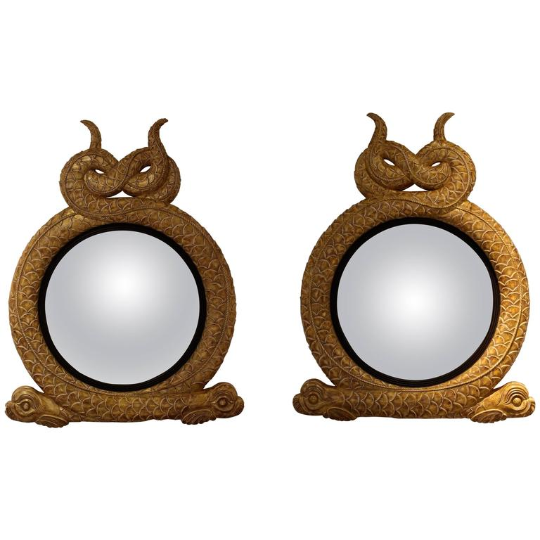 Pair of Regency Style Giltwood and Parcel Ebonized Convex Mirrors
