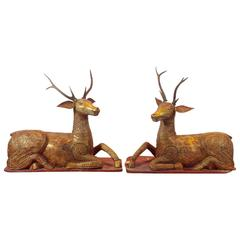 Pair of Burmese Gilt Teakwood with Glass Inlay Deer