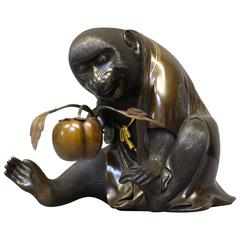 Antique Japanese Bronze Monkey Holding a Peach