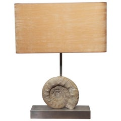 A Pair of Limestone Nautilus Shell Table Lamps