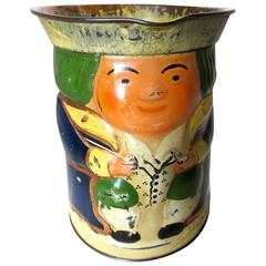 """Toby"" Jug Still Bank and Biscuit Tin, circa 1910"