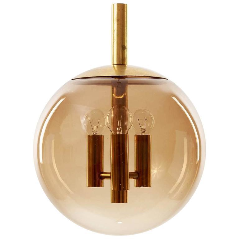 Limburg Pendant Light Brass and Amber Tone Glass Globe, 1960s