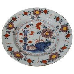 An 18th Century Dutch Delft Polychrome Charger