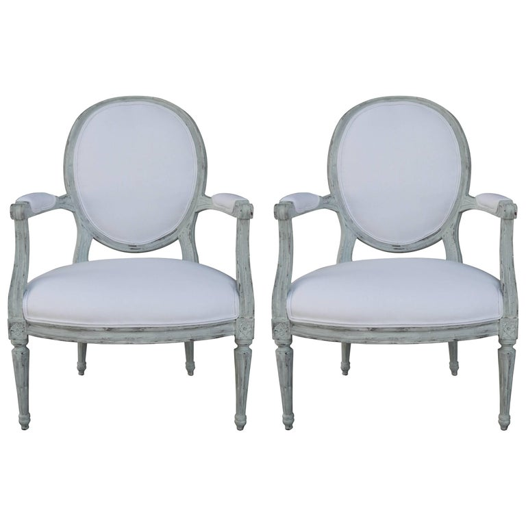 Pair of Louis XVI Style Painted Open Armchairs, Early 20th Century For Sale