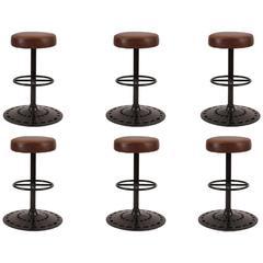 Six Leather and Cast Iron Swivel Barstools