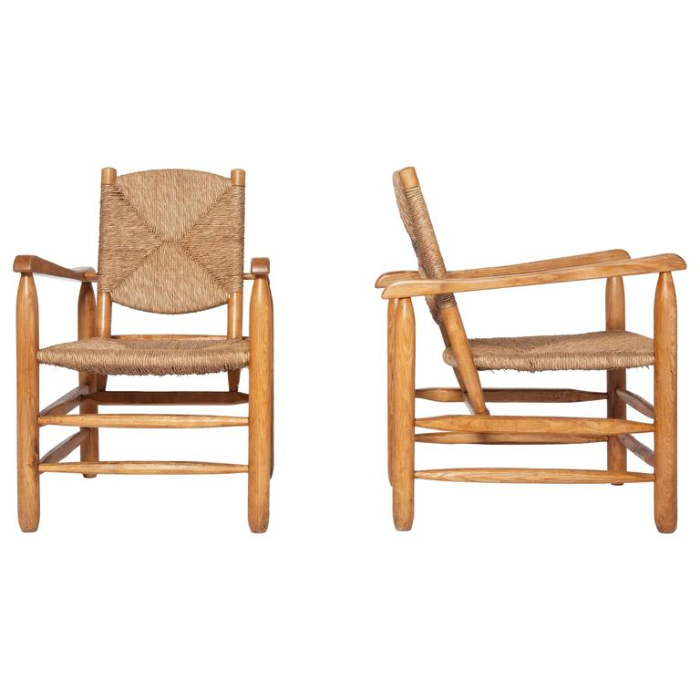 Charlotte Perriand, Pair of Rush Armchairs For Sale