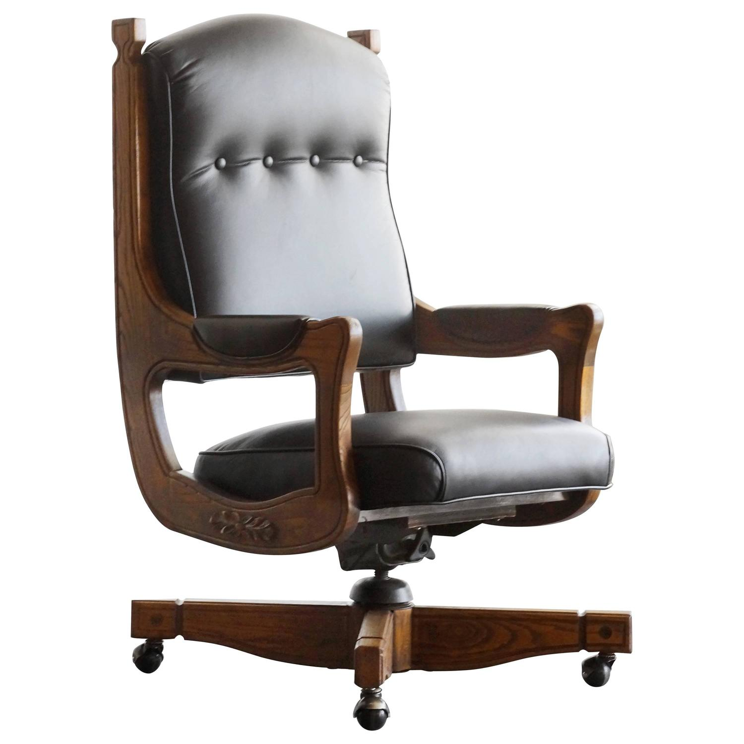 Antique chesterfield captains chair in oak and leather at for Antique leather chairs