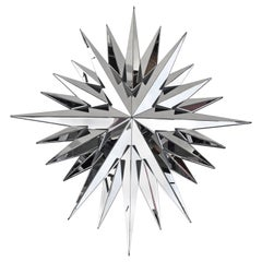 Faceted star-shaped mirror, contemporary work