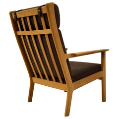 Hans Wegner Mid-century modern Brown Danish oak lounge chair