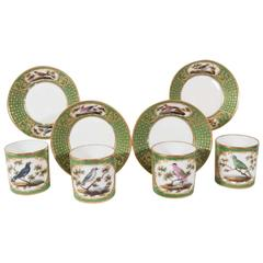 Four Paris Porcelain Coffee Cans with Hand-Painted Birds on a French Green Groun