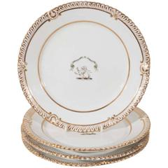 A Pair of Armorial Porcelain Plates in White and Gold