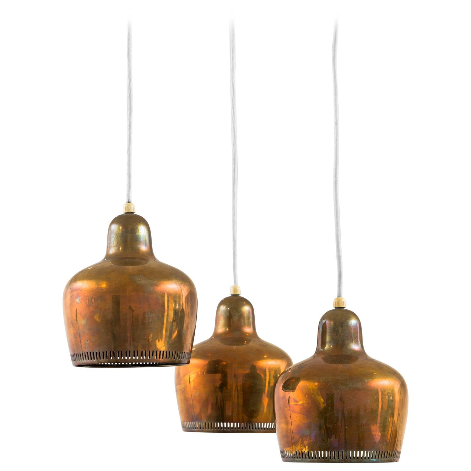 Three golden bell hanging lamps model a330 at 1stdibs for Chaise 66 alvar aalto