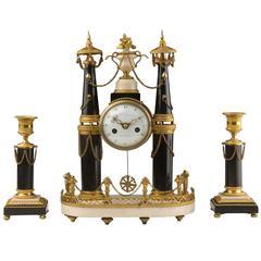 Gilt Bronze Marble Clock and Candlesticks. Louis XVI Period