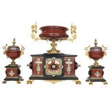 Three-Piece Rouge Marble, Bronze and Champleve Enamel Clock Ganiture Set