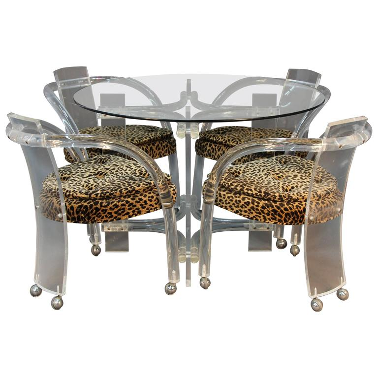Lucite table and four chair set with leopard print seats for Four chair dining table set