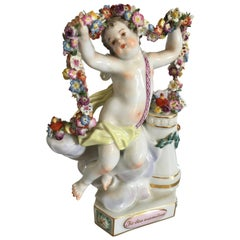 Meisen Figurine of Winged Putti Holding a Floral Wine