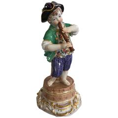 Meissen Figurine of Boy with Flute and Wine Barrel