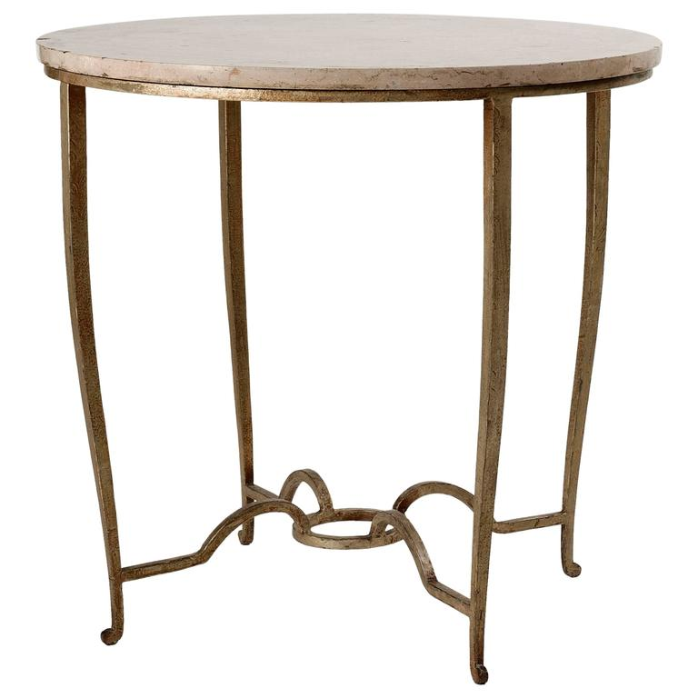 Maison Ramsay, Gilt wrought iron and travertine table, France, c. 1945 For Sale