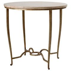 Maison Ramsay, Gilt wrought iron and travertine table, France, c. 1945