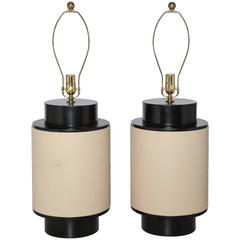 Substantial Pair of Beige Leather Wrapped Black Enamel Wood Barrel Table Lamps