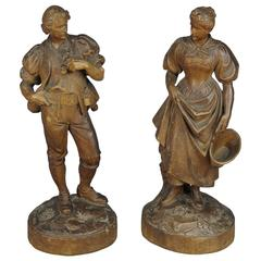 Expressive Carved Statues of a Maid and Farmer by Johann Huggler