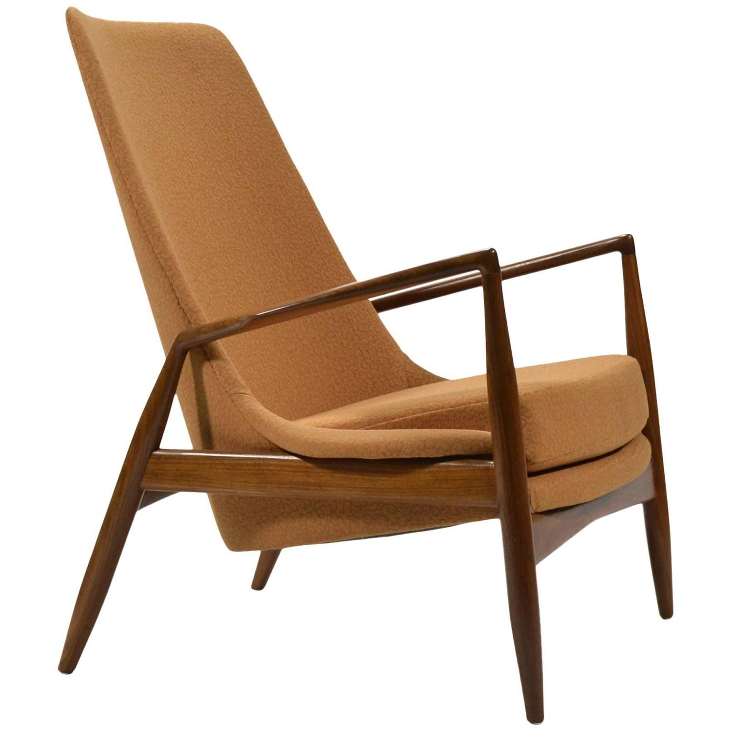 This sculptural pair of lounge chairs by ib kofod larsen is no longer - Ib Kofod Larsen High Back Seal Chair