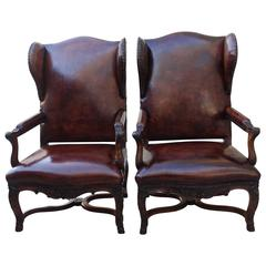 Pair of French Regence Style Leather Wingback Armchairs