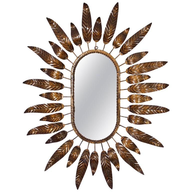 Large Mid-Century Modernist Gilt Iron Oval Sunburst Mirror Framed with Leaves