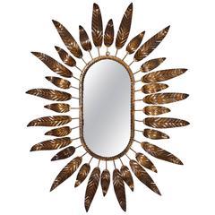Large Mid-Century Modernist Gilt Iron Oval Sunburst Mirror Framed with Leaves