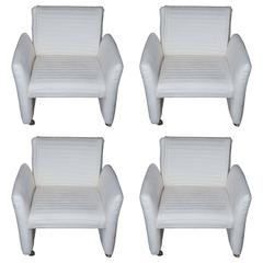 Set of Four Mid-Century Armchairs on Castors