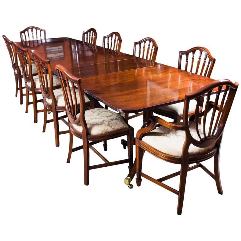 Antique regency three pillar dining table and ten chairs for Pillar dining table