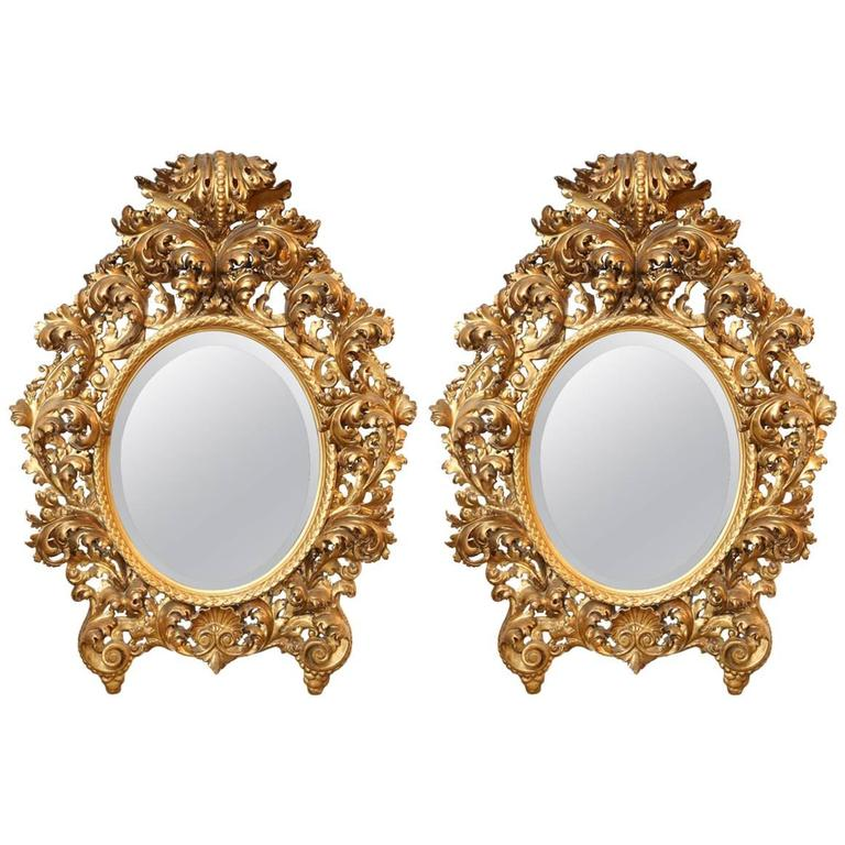 Pair of 18th Century Baroque Carved and Gilded Mirrors