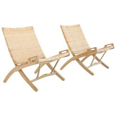 Pair of Hans Wegner Oak and Cane Folding Lounge Chairs